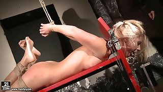 Nikky gets tied up and abused by dominatrix Mandy