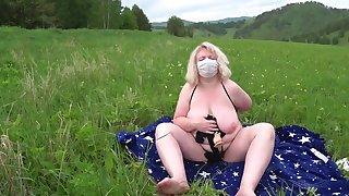 Lesbians BBW having fun outdoors on the grass. Mature milf doggystyle in mini bikini shakes big tits and fat butt.
