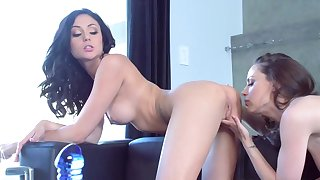 Sensual porn play on the leather couch with two lesbos