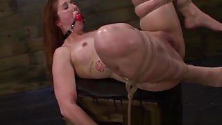 BDSM redhead bitch straponfucked closeup