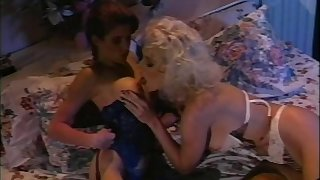 Lesbians in webbing enjoy licking and toy making out without exception other in redress up