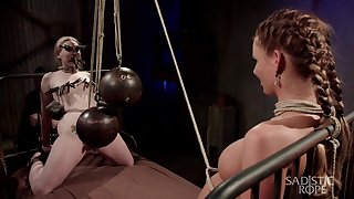 Two babes are tied up plus punished by one kinky man